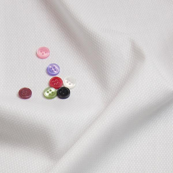 ボタンとホワイト特殊の生地