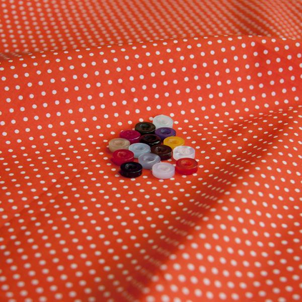 ボタンとオレンジ特殊の生地